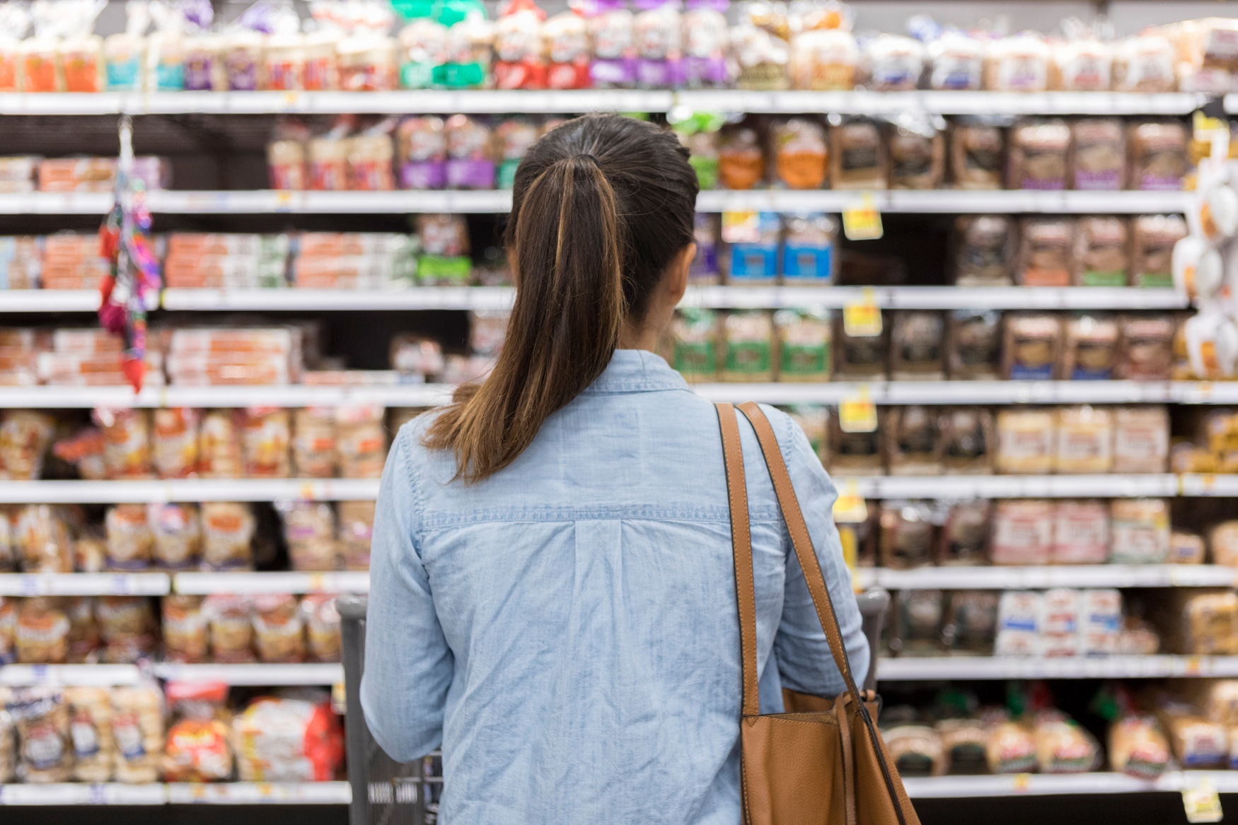 unrecognizable-woman-marvels-at-grocery-selection