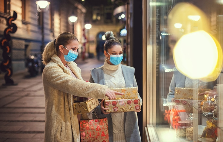 Family Shopping Christmas Gifts During Covid 19 Pandemic. They Wears A Protective Mask To Protect From Coronavirus Covid 19.