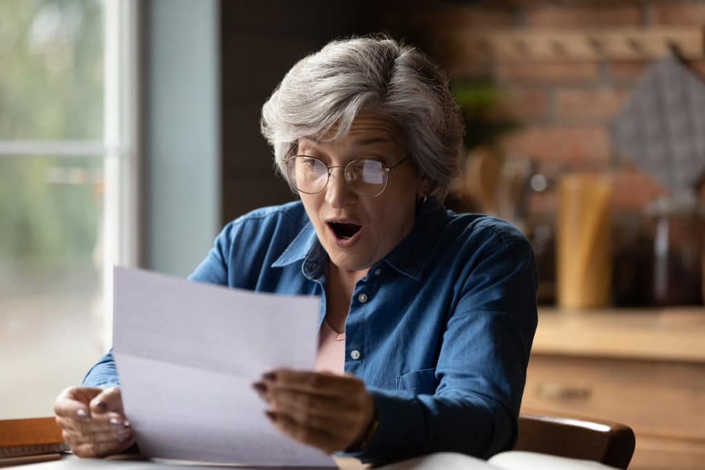 Close Up Overjoyed Woman Wearing Glasses Reading Letter